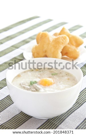 Traditional chinese porridge rice gruel in white bowl, congee.