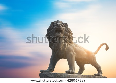 Traditional Chinese stone lions, Bund in Shanghai before the old building. - stock photo