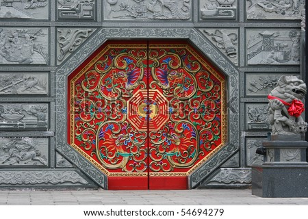 Traditional Chinese style door at a temple. This door has eight sides and is red in color.  It is decorated in traditional Chinese style. - stock photo