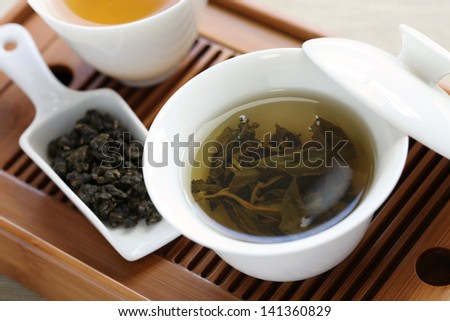 traditional chinese tea ceremony,oolong tea, gaiwan, tasting cup, bamboo tea tray - stock photo