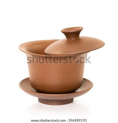 traditional Chinese tea cups on the plain background - stock photo