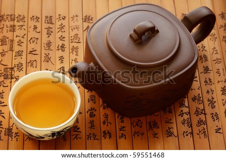 Traditional chinese tea on bamboo books - stock photo
