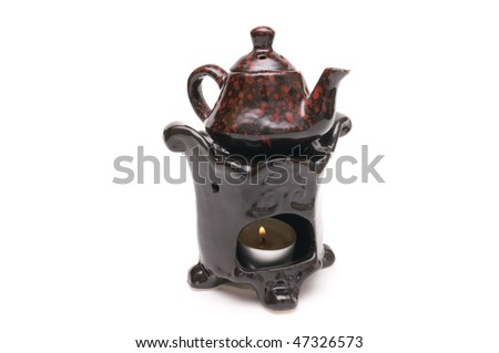 Traditional Chinese teapot with candle