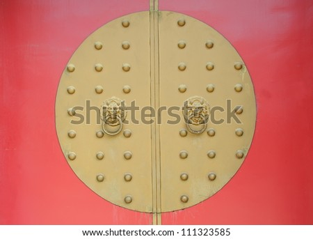 traditional chinese temple with guardian door knockers - stock photo