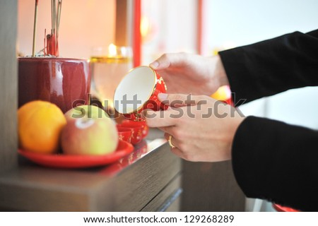 Traditional Chinese wedding tea ceremony serving to ancestor. - stock photo
