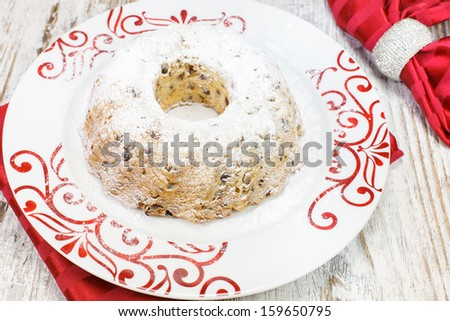 Traditional Christmas cake with raisins, Viewed from above. Shallow Dof - stock photo