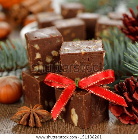 traditional Christmas chocolate fudge close-up on a brown background - stock photo