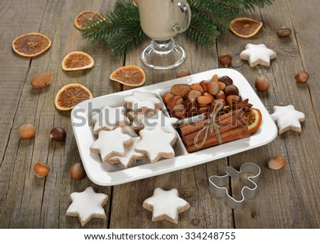 Traditional Christmas cookies zimtsterne with nuts and spices - stock photo