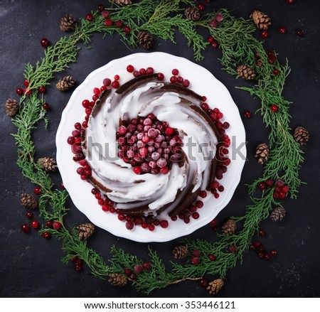 Traditional Christmas Fruit Cake pudding with marzipan and cranberry in the glaze decor on a Christmas decoration background.selective focus. - stock photo