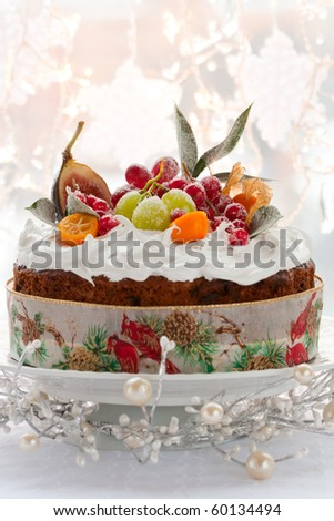 Traditional Christmas fruit cake with white frosting and sugared fruits - stock photo