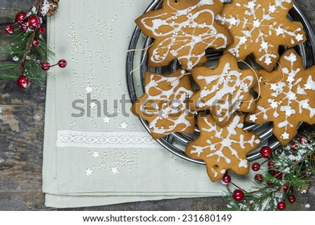 Traditional Christmas gingerbread cookies on rustic wooden background