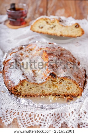 Traditional Christmas homemade stollen with raisins and nuts. - stock photo