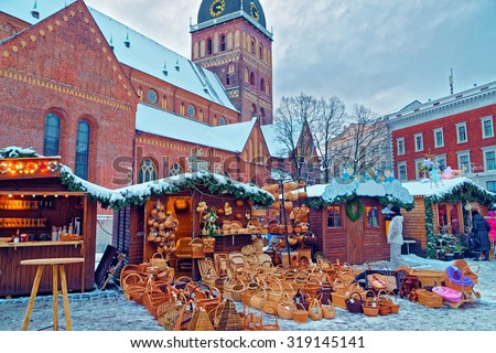 Traditional Christmas market stall with straw basket souvenirs displayed for sale in the Old Town of Riga, Latvia - stock photo