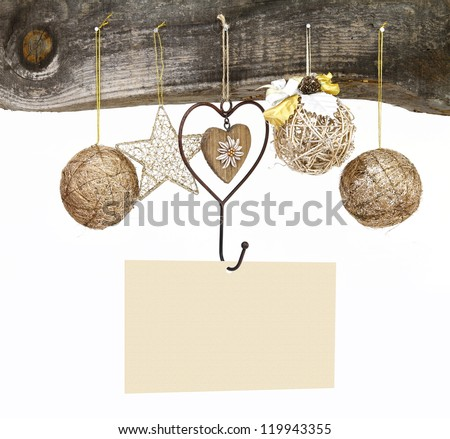 Traditional Christmas ornaments and blank card hanging on a wooden background - stock photo