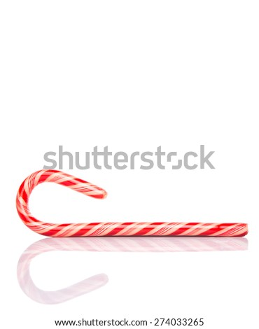 Traditional Christmas red and white stripe candy cane over white background