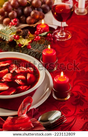 Traditional Christmas red borscht with meat filled dumplings
