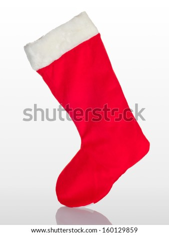 Traditional Christmas stocking on a white background - stock photo