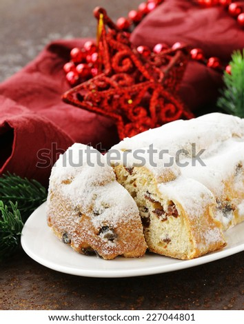 traditional Christmas stollen cake with raisins and powdered sugar - stock photo