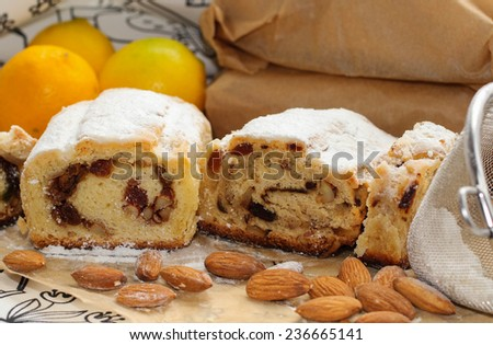 Traditional Christmas Stollen with raisins, almonds and candied