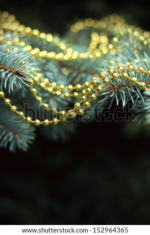 Traditional christmas tree decorated with golden garland - stock photo