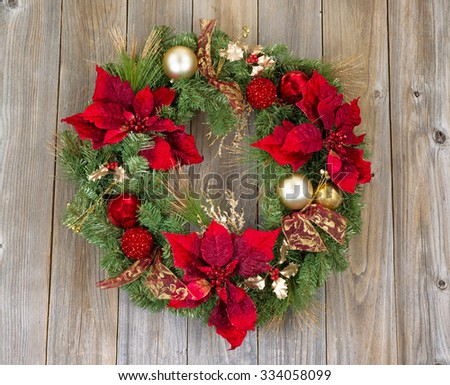 Traditional Christmas wreath on rustic cedar wood. Boards in vertical pattern.