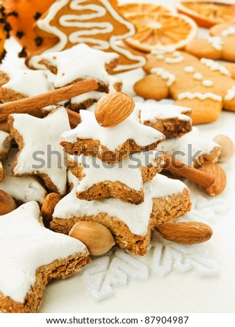 Traditional cinnamon cookies Zimtsterne with nuts and spices. Shallow dof. - stock photo