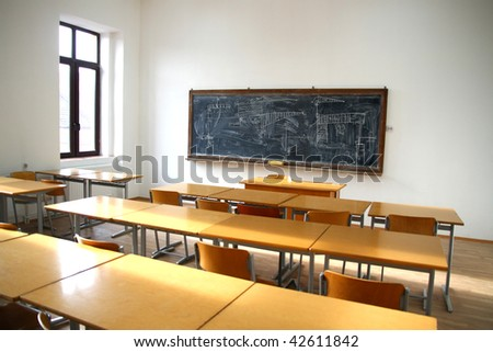 traditional classroom interior with blackboard and desks - stock photo