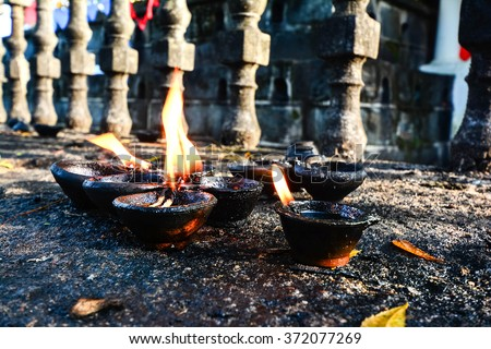 Traditional Clay Lamps Lit At The Buddhist Temple In Sri Lanka. Clay Lamps Lit At Local Festivals As Light Is Traditionally Associated With The Spirit, They Are An Essential Part Of Sacred Ritual