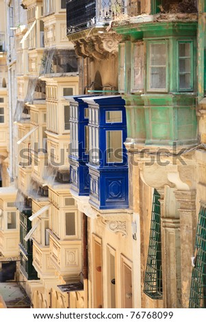 Traditional closed wooden balconies of Valletta city in Malta, Europe. - stock photo