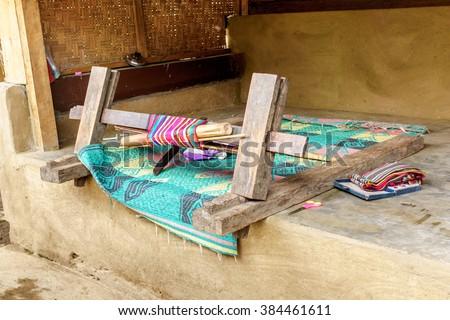 Traditional cloth weaving machine at Sasak village, Desa Sasak Sade, Lombok Indonesia. - stock photo
