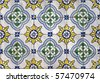 Traditional colored decorative tiles covering many buildings in Lisbon, Portugal - stock photo