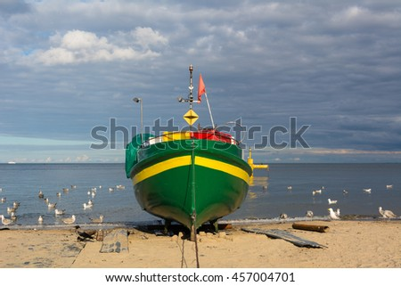 Traditional colorful fishing boat in Gdynia. Sea beach in Orlowo. Poland