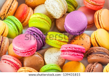 Traditional colorful french macarons are sweet meringue-based confection. - stock photo