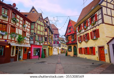 Traditional colorful half timbered houses with Christmas decoration in the early morning in Colmar, Alsace, France - stock photo