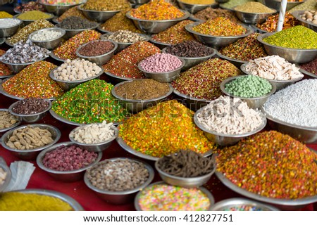 Traditional colorful indian spicesin bawls on the marketplace  - stock photo