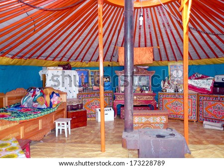 traditional colorful interior in a ger / yurt from  the nomadic people in mongolia - stock photo