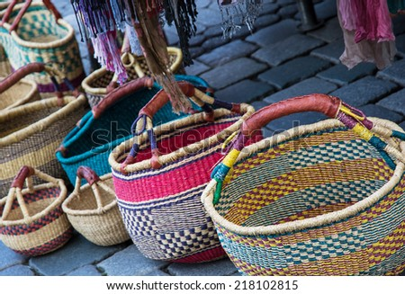 Traditional colorful wicker baskets on the stone pavement. - stock photo