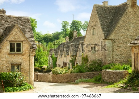 Traditional Cotswold cottages in England, UK. spring. Bibury is a village and civil parish in Gloucestershire, England. - stock photo