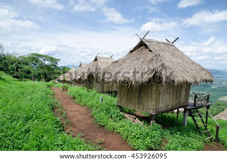 Traditional cottage in the village of Akha tribe atop the mounta - stock photo