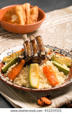 Traditional couscous dish with lamb ribs and vegetables. Still life. The image is describing moroccan cuisine - stock photo