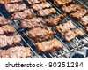 Traditional Croatian cevapcici on the grill - stock photo