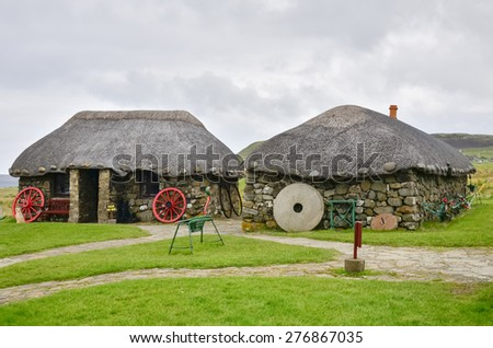 Traditional crofters cottages on the Isle of Skye, Scotland - stock photo