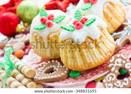 Traditional cuisine. Christmas treats, cupcakes, cookies on a festive table close up, selective focus - stock photo