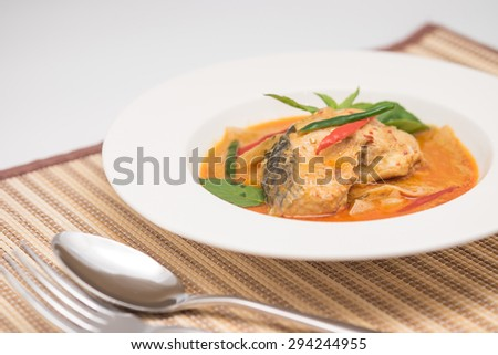 Traditional cuisine, fish in red curry paste or sauce with hot chili for spicy Thai food background - stock photo