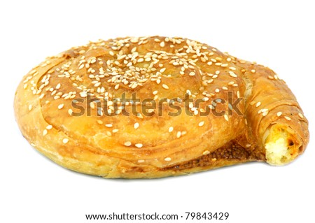 Traditional Cypriot village style cheese pie. Isolated on white background