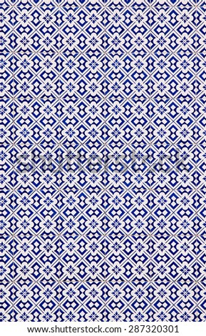 Traditional decorative tiles on facade of old house, Porto, Portugal - stock photo