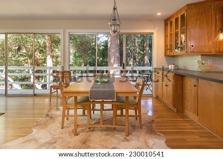 Traditional designed kitchen with dining area in mid century home. - stock photo