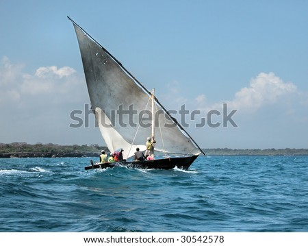 Traditional Dhow-Boat on waves Indian Ocean - near the coast of Kenya.