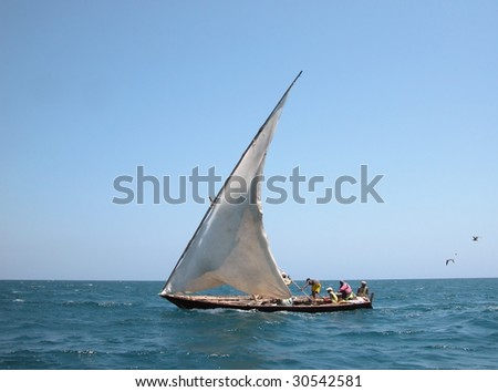 Traditional Dhow-Boat on waves Indian Ocean - near the coast of Kenya. - stock photo