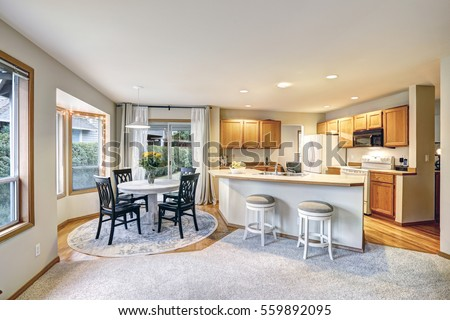 Traditional Dining And Kitchen Room Design Has White Long Island With Bar Stools